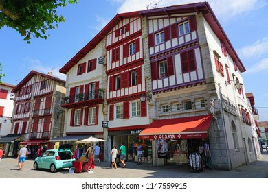 SAINT-JEAN-DE-LUZ, FRANCE -8 JUL 2018- View of a street in Saint-Jean-de-Luz-Ciboure, an historic resort beach town on the Socoa Bay in the Basque Country, France.