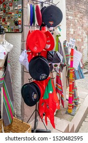 SAINT-JEAN-PIED-DE-PORT, FRANCE - AUGUST 20, 2019. The town is on 3 paths of the pilgrimage of Saint-Jacques-de-Compostelle. Traditional Basque berets in a downtown shop.
