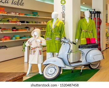 SAINT-JEAN-PIED-DE-PORT, FRANCE - AUGUST 20, 2019. The town is on 3 paths of the pilgrimage of Saint-Jacques-de-Compostelle. shop of linen, bathrobes and vintage Scooter in decoration.