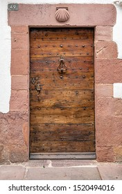 SAINT-JEAN-PIED-DE-PORT, FRANCE - AUGUST 20, 2019. The town is on 3 paths of the pilgrimage of Saint-Jacques-de-Compostelle. Door of rural lodgings with the symbol of Saint-Jacques-de-Compostelle.