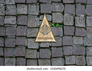SAINT-JEAN-PIED-DE-PORT, FRANCE - AUGUST 20, 2019. The town is located on 3 paths of Saint-Jacques-de-Compostelle. Bronze emblem indicating the EUROPA COMPOSTELA 2010 conference.