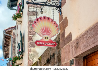 SAINT-JEAN-PIED-DE-PORT, FRANCE - AUGUST 20, 2019. The town is located on 3 paths of Saint-Jacques-de-Compostelle. Sign in the shape of shell symbol of St Jacques de Compostela.