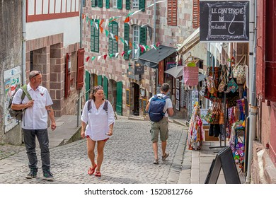 SAINT-JEAN-PIED-DE-PORT, FRANCE - AUGUST 20, 2019. The town is on 3 paths of pilgrimage to St Jacques de Compostela. City Center with these old streets, these houses reminiscent of Venice.