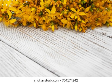 Saint-John's-wort flowers  on a old wooden table