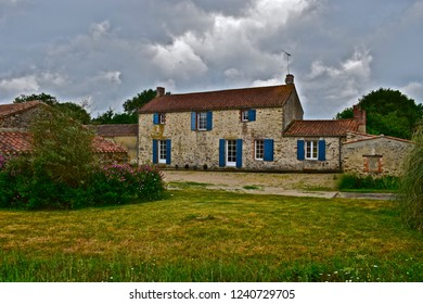 Saint-Julien-des-Landes, Vendée / France - 6/9/2017 : Pretty, traditional French Gîte with blue shutters to  windows, located at La Garangeoire, Vendėe, Western France.