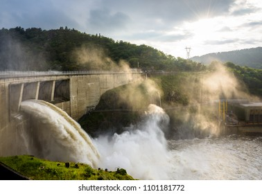 Saint-Just-Saint-Rambert, France - May 15, 2018: The Grangent dam, seen during a water release at sunset, is a concrete arch dam built in 1957 on the river Loire in the surroundings of Saint-Etienne.