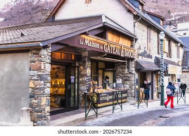 Saint-Lary-Soulan, France - December 26, 2020: Facade of the famous boutique Maison du Gateau à la Broche (house of the gateau a la broche) in the city center on a winter day