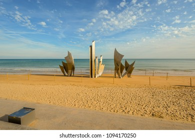 Saint-Laurent-sur-Mer, France - September 18 2017: The WW2 American D-Day landing Omaha Beach monument Les Braves Memorial on the sandy beach at Saint-Laurent-sur-Mer at Normandy, France