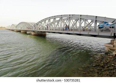 Saint-Louis, Senegal-April 17, 2014: The July 14, 1897 opened Faidherbe bridge spans the Senegal river linking the island-city of St.-Louis to the mainland and has a metal deck of riveted girders.
