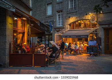 Saint-Malo, France - July 30, 2014: People relaxing on a summer summer evening in a street cafe in Saint-Malo.