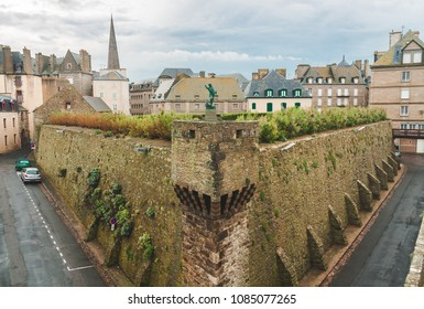 SAINT-MALO, FRANCE - OCTOBER 7, 2009: Old ramparts inside Saint-Malo fortification walls with statue of Robert Surcouf, French privateer and corsair