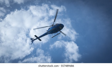 SAINT-MALO, FRANCE - SEPTEMBER 23, 2016: Blue helicopter in the air of Saint-Malo, Bretagne