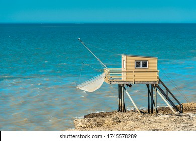 Saint-Palais-sur-Mer, France: A traditional local fisherman's hut on stilts with a distinctive carrelet fishing net typical of this area built on the rock on the coast.