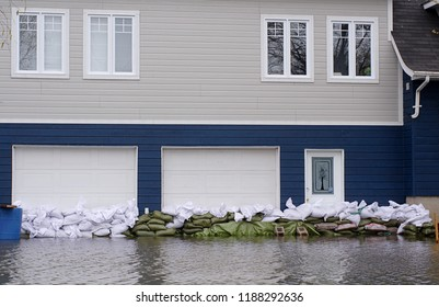 Saint-Paul-de-L'Ile- Aux - Noix, Quebec, Canada - May 7, 2011 - Sandbags packed in front of garages and home during historic floods in an attempt to protect home from overflowing Richelieu River