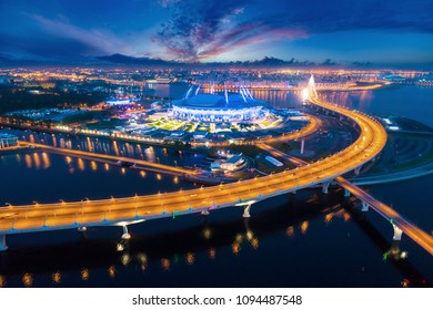 Saint-Petersburg,  Krestovsky Island. Russia. The Neva River flows into the Gulf of Finland. High-speed highway. Stadium. Evening Petersburg. Cities of Russia. Bridges of Petersburg.