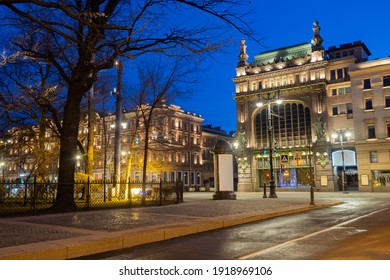 Saint-Petersburg at night. Cities of Russia. Nevsky Prospekt without people. Nevsky Prospekt illuminated under a dark blue sky. Eliseevsky store in St. Petersburg. Merchant Eliseev house.