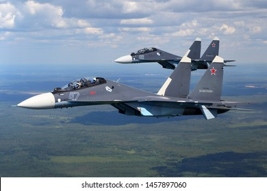 SAINT-PETERSBURG REGION, RUSSIA - July 16, 2019: Sukhoi Su-30SM jet fighter of Russian Navy seen here during Navy parade rehearsal while  imitating aerial refueling with Ilsyuhin IL-78M.