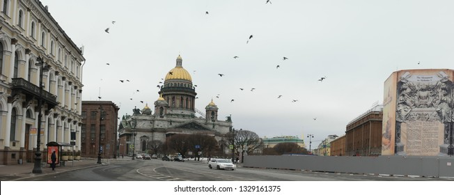 Saint-Petersburg, Russia 02 march 2019: St. Isaac's cathedral in early spring with flock of birds flying about