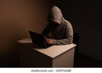 Saint-Petersburg, Russia, 05.13.19, a man with a laptop in a dark room