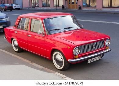 "Saint-Petersburg/ Russia - 06042019 :Vintage red russian soviet automobile  Lada-2101 ""Zhigili"" at the city street"