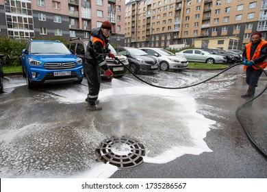 Saint-Petersburg, Russia / 2020.05.19 /  man disinfect the street with a special solution