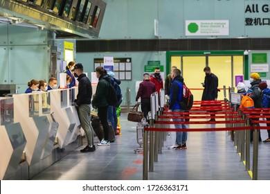 Saint-Petersburg, Russia, 30 April 2020: Registration desk in Pulkovo International Airport. Masked staff check in passengers. International flights canceled due to coronavirus