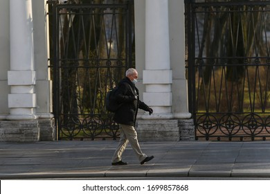 Saint-petersburg, Russia - 7 April 2020: : Nevsky Prospekt. An old man in mask walking on the sidewalk. People don't want to stay at home due to coronavirus