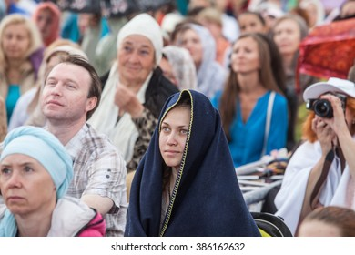 Saint-Petersburg, Russia - 8 August 2015: The mass meditation in a city park under the guidance of a yoga guru. Large numbers of people meditating in a park outdoors in summer