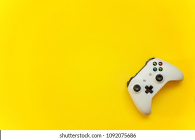 SAINT-PETERSBURG, RUSSIA - APRIL 13, 2018: White joystick xbox one s gamepad, game console on yellow background. Computer gaming competition videogame control concept