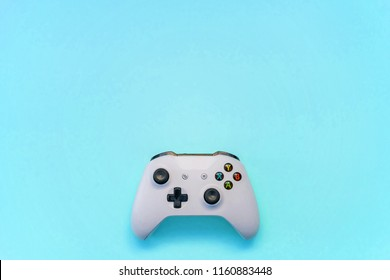 SAINT-PETERSBURG, RUSSIA - APRIL 13, 2018: White joystick xbox one s gamepad, game console on blue pastel background. Computer gaming competition videogame control concept
