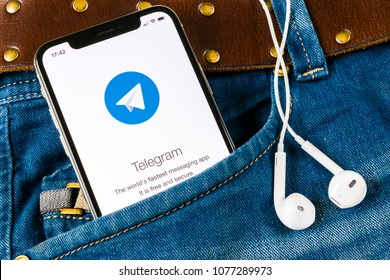 Saint-Petersburg, Russia, April 14, 2018: Telegram application icon on Apple iPhone X screen close-up in jeans pocket. Telegram app icon. Telegram is an online social media network. Social media app