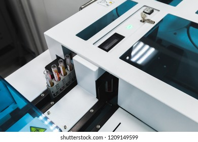 Saint-Petersburg, Russia - April 6, 2018:  Tubes with blood are on the tray of Cobas pre-analytical system. Clinical laboratory and blood bank fully automated equipment