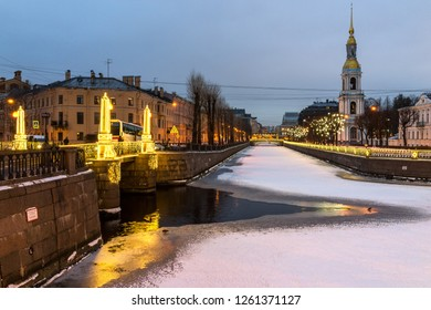 SAINT-PETERSBURG, RUSSIA - December 15, 2018: Seven Bridges in the New Year's festive lighting. View of the Nikolsky Cathedral's Bell Tower and the Kryukov Canal Embankment on a winter evening