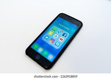 Saint-Petersburg / Russia - December 18 2018: Iphone with applications of social media, Instagram, Whatsapp, Telegram, Facebook, Snapchat, YouTube, Twitter, Google, Skype