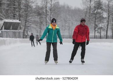 Saint-Petersburg, Russia - December 2, 2016: Urban outdoor ice rink in the park.