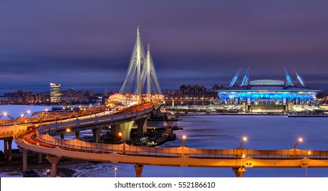 Saint-Petersburg, Russia - December 28, 2016: Winter cityscape to the football stadium to the World Cup in 2018, cable-stayed bridge and highway at night.