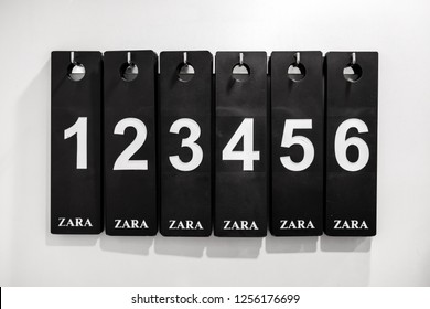 Saint-Petersburg / Russia - December 3 2018: Zara fashion store, black nameplates with white digits at the fitting room wall