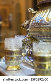 SAINT-PETERSBURG, RUSSIA - DECEMBER 3, 2018: Detail of antique silver tableware with enamel decor: punch bowl with glasses in neo-russian style. Exgibition of the Faberge Museum in Shuvalov Palace.