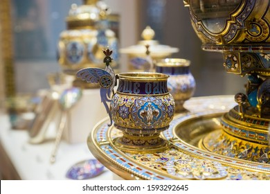 SAINT-PETERSBURG, RUSSIA - DECEMBER 3, 2018: Detail of antique silver tableware with enamel decor: punch bowl with cups in neo-russian style. Exgibition of the Faberge Museum in Shuvalov Palace.
