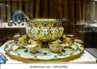 SAINT-PETERSBURG, RUSSIA - DECEMBER 3, 2018: Antique tableware with enamel decor: punch bowl with cups in neo-russian style. Exgibition of the Faberge Museum in Shuvalov Palace.