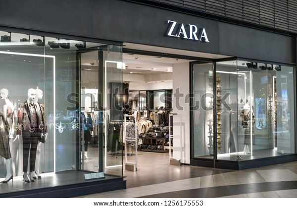 Saint-Petersburg / Russia - December 3 2018: Zara fashion store in shopping center. Brand logo and view inside the store