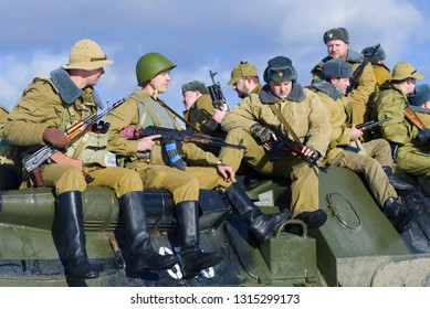 """SAINT-PETERSBURG, RUSSIA - FEBRUARY 17, 2019: Soviet soldiers on the armor of an armored personnel carrier. Fragment of the military-historical festival """"Afghan - Operation"""" Highway """""""