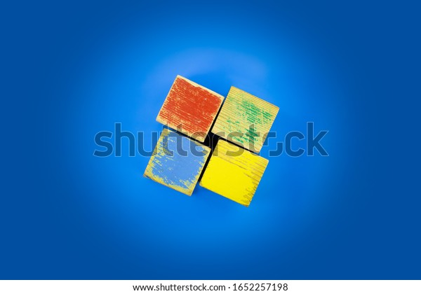 Saint-Petersburg, Russia - February 21, 2020: Old and shabby children's cubes are laid out in the form of a Windows logo. The problem of an outdated PC operating system and the need to update it.