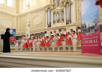 SAINT-PETERSBURG, RUSSIA - FEBRUARY 25, 2018: Xiaman Media Group Students' Choir Happy Childhood, China performs during V Children and Youth World Choral Championship. First championship was in 2011
