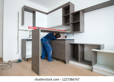 SAINT-PETERSBURG, RUSSIA - FEBRUARY 26, 2018: Assembling the kitchen in a new apartment