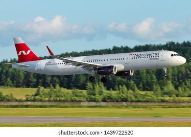 SAINT-PETERSBURG, RUSSIA - JULY 01, 2019 - Nordwind Airlines Airbus 321 landing in Pulkovo International Airport.