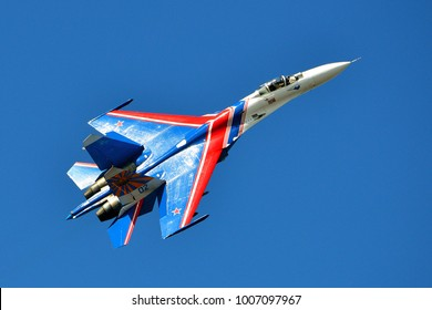 Saint-Petersburg, Russia, July 02, 2015: Russian Su-27 (Flanker-B) from aerobatic team Russians Knights shows demonstration flight at port area in St. Petersburg.
