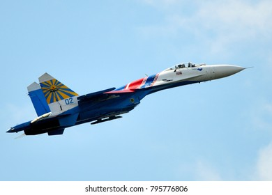 Saint-Petersburg, Russia, July 05, 2015: Russian Su-27 (Flanker-B) from aerobatic team Russians Knights shows demonstration flight at port area in St. Petersburg.