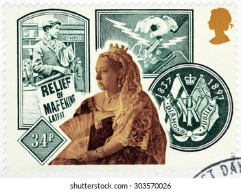 SAINT-PETERSBURG, RUSSIA - JULY 14, 2015: A stamp printed by GREAT BRITAIN shows Queen Victoria against images of Newspaper Placard and Morse Key, circa September, 1987.