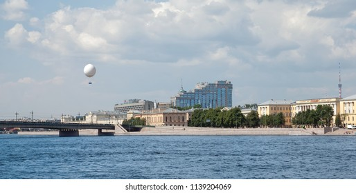 SAINT-PETERSBURG, RUSSIA – JULY 15, 2018: Aerolift, helium tethered balloon for excursions over Hotel Saint-Petersburg and Neva River with Liteyny Bridge and embankments